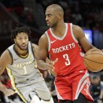 Houston Rockets' Chris Paul (3) drives past Cleveland Cavaliers' Derrick Rose (1) in the second half of an NBA basketball game, Saturday, Feb. 3, 2018, in Cleveland. The Rockets won 120-88. (AP Photo/Tony Dejak) ORG XMIT: OHTD111