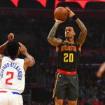 LOS ANGELES, CA - JANUARY 28: Atlanta Hawks Forward John Collins (20) shoots over Los Angeles Clippers Guard Shai Gilgeous-Alexander (2) during a NBA game between the Atlanta Hawks and the Los Angeles Clippers on January 28, 2019 at STAPLES Center in Los Angeles, CA. (Photo by Brian Rothmuller/Icon Sportswire)