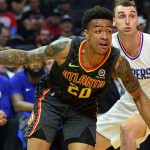 January 8, 2018; Los Angeles, CA, USA; Atlanta Hawks forward John Collins (20) moves the ball as guard Malcolm Delaney (5) provides coverage against Los Angeles Clippers forward Sam Dekker (7) during the first half at Staples Center. Mandatory Credit: Gary A. Vasquez-USA TODAY Sports