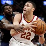 Cleveland Cavaliers' Larry Nance Jr. (22) drives against Detroit Pistons' James Ennis (33) in the first half of an NBA basketball game, Monday, March 5, 2018, in Cleveland. (AP Photo/Tony Dejak)
