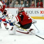Mandatory Credit: Photo by Ralph Freso/AP/Shutterstock (10049325c) Arizona Coyotes goalie Darcy Kuemper (35) tries to get into position after making a save as New York Rangers center Brett Howden (21) skates in with the puck during the first period of an NHL hockey game, in Glendale, Ariz Rangers Coyotes Hockey, Glendale, USA - 06 Jan 2019