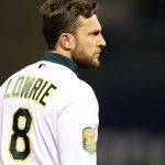 Sep 18, 2018; Oakland, CA, USA; Oakland Athletics second baseman Jed Lowrie (8) stands on third base during the fourth inning against the Los Angeles Angels at Oakland Coliseum. Mandatory Credit: Darren Yamashita-USA TODAY Sports