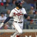 Jul 24, 2019; Atlanta, GA, USA; Atlanta Braves right fielder Nick Markakis (22) hits a single against the Kansas City Royals in the fourth inning at SunTrust Park. Mandatory Credit: Brett Davis-USA TODAY Sports